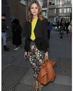Olivia Palermo in florarl pants and neon shirt