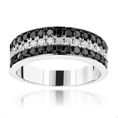 This luxurious and unique 3 Row White Black Diamond Wedding Band by Luxurman in 10K gold showcases 1.35 carats of dazzling pave set round diamonds. Featuring a 3-row design and a highly polished gold finish, this white and black diamond ring is available in 10K white, yellow and rose gold and can be customized with any color diamonds or color patterns. Also available in 14k, 18k gold and Platinum as custom options.