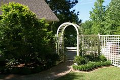 Brinker Garden - entry arch with rose by Pandorea..., via Flickr