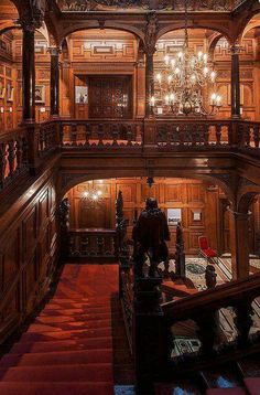 """A view down the staircase of the Astor House - an architectural marvel in London. Two Temple Place, known for many years as """"Astor House"""", is a building situated near Victoria Embankment. It is both an architectural gem and a veritable treasure house of e"""