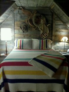 Wall display with saddle, blanket, hat, rope
