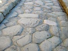 roman roads   File:Roman Road Surface at Herculaneum.jpg - Wikimedia Commons