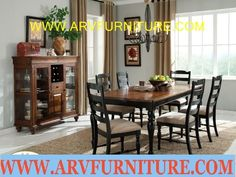 The Price is for Table & 6 Chairs.  Beautiful Casual Country Collection.  Two-tone table with a dark oak veneer top and black finish base is accented with a glass door curio also in a dark oak veneer finish.  Size (LxWxH) Table: 66-84 x 42 x 30, Chair: 19 x 24 x 40, Curio: 52 x 20 x 50.  Curio $930, table & 6 Chairs $1249