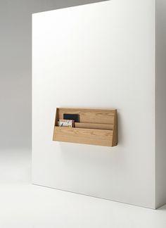 Móvel recolhido a parede, proporcionando espaço de circulação no ambiente.