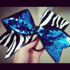 I wish we did competitive cheer. They have such cute uniforms!!
