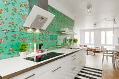 .:* L - This is possibly the most gorgeous (and simplest) kitchen I've ever seen. I would never have thought to add that pop of bright floral wallpaper -- but I love the way it contrasts with the white counters and black stripped rug [and I hate white counters!]