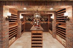"emperature controlled wine cellar feature brick and stone walls and ceiling and custom mahogany wine racks"" ""Simple, change brick to different or stone though."" ""use stone for columns"" ""beige stone floor...stone ceiling"" ""Shelving style and space for boxes"" — bethannharvey"