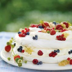 Layers of meringue are adorned with raspberries, strawberries, currants, and wild blueberries -- nature's delectable take on the good old red, white, and blue.
