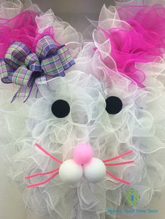 Adorable Easter Bunny Wreath.  This cute bunny is big, measures about 36 tall and is only available for local delivery in the Findlay, Oh. area.  Use the coupon code local to waive the shipping fee.  Can be made to order in a smaller size.  Remember to follow me on Pintrest: pintrest.com/ribbonandbowsho and like ribbon and bows home decor on Facebook.  Thanks for visiting my shop! Michelle