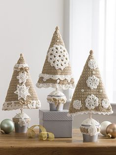 Decorating with neutral tones gives an elegance to your home. Crochet this trio of trees and display them on your entry table, on the mantel or anywhere you want to add a bit of holiday spirit.