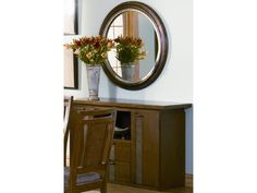 A circular mirror can soften an otherwise masculine room. #CORT #design #tip