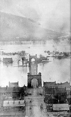 1. Wheeling Suspension Bridge and flooding Ohio River, 1852