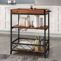 Dotted Line™ Enos Kitchen Cart with Solid Wood Top & Reviews | Wayfair Kitchen Island Cart, Kitchen Trolley, Kitchen Islands, Kitchen Items, Kitchen Storage, Storage Spaces, Kitchen Organization, Rolling Kitchen Cart, Stainless Steel Counters