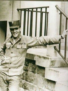 Specialist 4th Class Sp4) Elvis Presley photographed beside the stairs to his rented house at Goethestraße 14 in Bad Nauheim, Germany in the second half of 1959. Elvis was promoted to this rank on June 1st, 1959.