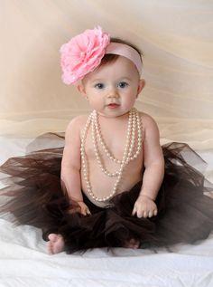 Baby photo with tutu, pearls & giant flower headband.