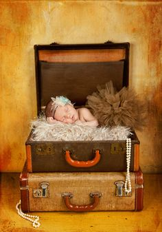 great use for my old suitcases...love the background too!
