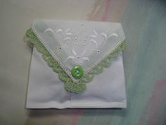 This beautiful sachet was created from a vintage (1940-1960) lady's handkerchief, with an inside bag of muslin. It…