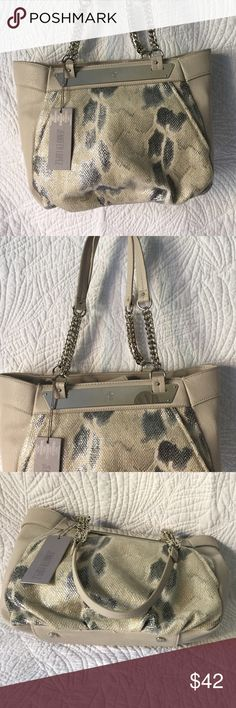 Jennifer Lopez Purse Jennifer Lopez Purse.  Grays with light tan color, chained double handles 10 inches long.  Purse measures 15 inches wide, 10 inches high,  5 inches wide in interior.  Two zipper compartments, slot for phone and snap close Top. Jennifer Lopez Bags