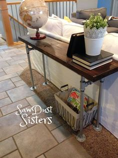 DIY Console/Sofa Table with Pipe Frame. No tools!! See tutorial at http://Sawdustsisters.com