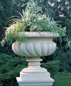 Superieur A Stylishly Ornate Cast Stone Garden Planter With Spiralled Gadrooning And  An Egg And Dart Rim.