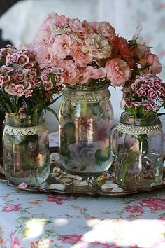 Love the jars with lace trims and pearls with the lovely flowers... very tea party looking.