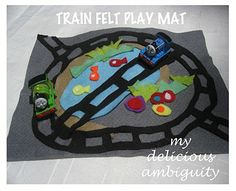 (Felt play mats - train track and construction) I like, but I think a table cloth that could be folded up and be nice and big might be even better. Maybe a bit of fabric paint? Hmmm...