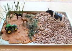 Create a farm small world scene using sensory materials to encourage sensory exploration, imaginative play, language development, and more!