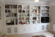 Fitted wardrobes and bookcases in London, shelving and cupboards