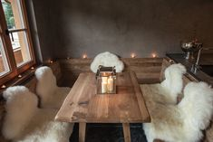 These sheepskins used as seating pads at this rustic table give an earthy, natural, warm feel, and yet they are cooled by the grey stuccoed wall in the back. Boutique Interior Design, Home Interior Design, Interior Decorating, New Kitchen Doors, Chalet Design, Chalet Style, Earthy Home Decor, Interior Window Shutters, Home Ceiling