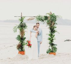 Tropical-themed wedding arch of palms and foliage // Tropical With a Hint of Neon: A Styled Shoot by the Beach Beach Wedding Reception, Beach Ceremony, Ceremony Backdrop, Wedding Reception Decorations, Wedding Ceremony, Wedding Chuppah, Wedding Arches, Elopement Wedding, Wedding Venues