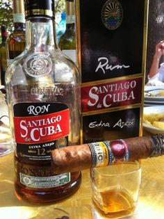 The best existing combination if one speaks of the best cigar in the world. A Cohiba with a Ron Santiago de Cuba Extra Añejo 12 Years, a tribute to the Rum Masters of Santiago de Cuba to Havana Cigars. Cigars And Whiskey, Good Cigars, Pipes And Cigars, Whiskey Bottle, Cigar Club, Cigar Bar, Rum, Havana Cigars, Cigar Smoking