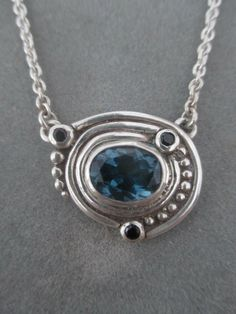 Sterling Silver Blue Topaz Pendant by RichelleJewelry on Etsy