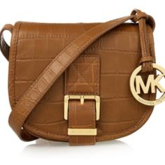 MICHAEL Michael Kors Crossbody Pre-loved condition. Does not come with the lanyard as shown in stock photo. Interior looks good except for minor pen stain on pocket which is visible in the last photo. Normal wear/scratches on hardware. Magnetic-snap flap closure, Adjustable strap, Exterior magnetic-snap slip pockets, Interior wall pocket, Logo-jacquard lining, Leather. MICHAEL Michael Kors Bags Crossbody Bags