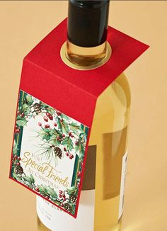 recycle christmas cards - I can't throw away beautiful cards. Love this re-use! Nice way to gift wine.