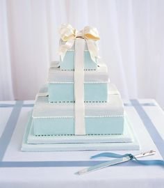 Brides.com: Ribbon-Themed Wedding Décor. Instead of a cake topper or flowers, wrap your cake with a delicious edible bow: Ask your baker to tie one on (a ribbon, that is!). Wedding cake with rolled fondant icing with sugar pearls and bow, from Confetti Cakes, NYC, confetticakes.com. We complemented our true-blue colors by decorating the table with double-faced satin ribbons, from Hyman Hendler  Sons, hymanhendler.com. Tablecloth, from Just Linens, 212-688-8808 or 631-283-8808. Knife, from…