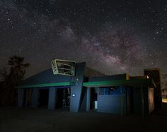 Milky Way over the arcade building at the abandoned Rock-A-Hoola Waterpark. Newberry Springs, California.