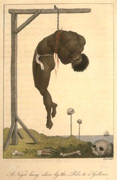 """""""A Negro hung alive by the ribs to a gallows""""; background shows skulls (presumably of beheaded slaves) on posts. This illustration was based on a 1773 eyewitness description. An incision was made in the victim's ribs and a hook placed in the hole. In this case, the victim stayed alive for 3 days until clubbed to death by the sentry guarding him who he had insulted"""