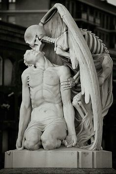 """The Kiss Of Death"" This astonishing sculpture forms part of Barcelona's Poblenou Cemetery. ""El Petó de la Mort in Catalan"" or ""El beso de la muerte"" in Spanish dates back to 1930. A winged skeleton bestows a kiss on the forehead of a handsome young man: is it ecstasy on his face or resignation? Little wonder the sculpture elicits strong and varying responses from whoever gazes upon it"
