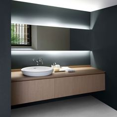 Indirect lighting as sole source of light at bathroom vanity.