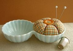 Adorable pin cushion made in a Japanese double-dish - I wonder if I could find something similar at the thrift store.