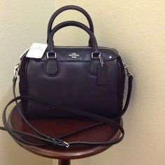 100% Authentic Coach Handbag 100% authentic  Coach handbag. Mix of leather & soft shearling. Color: black Coach Bags