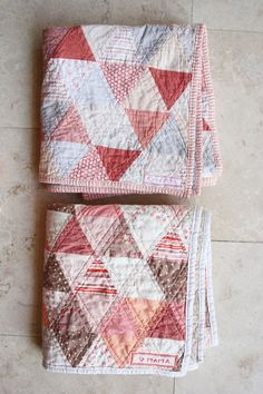 Triangle quilts- very nice colours, love pink now, in my advancing years.....
