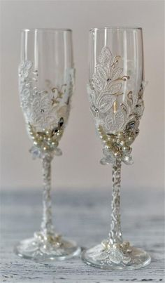 Items similar to Personalized wedding flutes Wedding champagne glasses Toasting flutes Champagne flutes ivory pearl rustic champagne flutes wedding set of 2 on Etsy Wedding Toasting Glasses, Wedding Unity Candles, Wedding Champagne Flutes, Champagne Glasses, Toasting Flutes, Unique Wedding Colors, Bride And Groom Glasses, Wedding Cake Server, Decorated Wine Glasses
