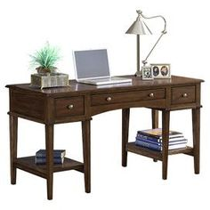 Give your den, master suite, or home office a studied air with this handsomely crafted desk, perfect for penning correspondence and working from home.    Product: Writing desk    Construction Material: Solids and wood composites    Color: Cherry   Features:  Ample convenient shelves and storage drawers    Simple styling    Will enhance any dcor   Dimensions: 31 H x 56 W x 24 D