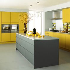 yellow cabinets may be a trend. liking the matte grey.
