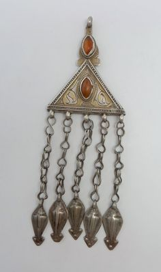 museum quality antique pendant from Central Asia, Tekke Turkmen. This 19 th century treasure is made of high grade silver(tested higher than 95 %