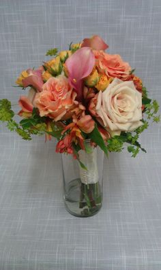 Wedding bouquet of salmon and coral tones with accents of yellow and chartreuse. Cobblestone