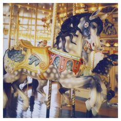 Polaroid Photograph- Carousel- Horse- Fair - Carnival - Pony - Gallop - Signed by Alicia Bock. via Etsy.