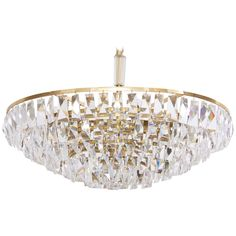 Extraordinary Huge Palwa Gilded Brass and Crystal Glass Chandelier | From a unique collection of antique and modern chandeliers and pendants at https://www.1stdibs.com/furniture/lighting/chandeliers-pendant-lights/