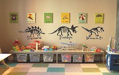 Custom dinosaur canvas wall art and decals in a kids bedroom or baby nursery theme
